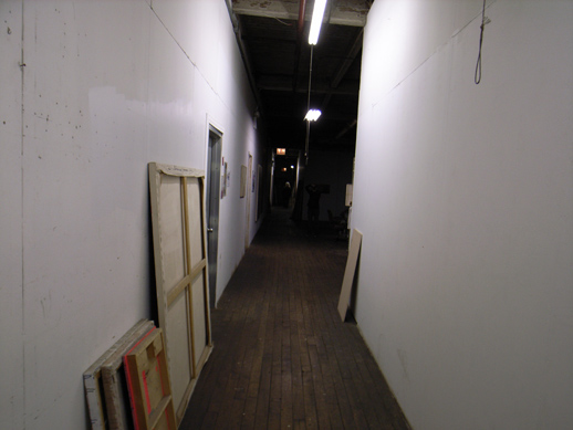 Corridor with art works to discard.