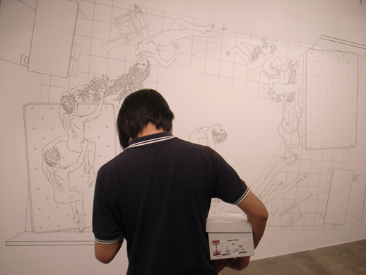 A massive wall drawing in the very back of the gallery.