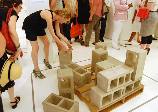 A woman stealthily repositions a piece of Sonya Blesofsky's concrete brick installation. Luckily, it's only paper-mâché. Photo © 2008 Teri Duerr.