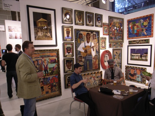 Ironic ''salon style'' booth setup of Red Truck Gallery from New Orleans. Gallerists playing cards.