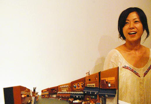 Osakan artist Yumiko Matsui with one of her miniature Japanese city streets. Her mini replicas of iconic Japanese city spaces were big crowd-pleasers. Photo © 2008 Teri Duerr.