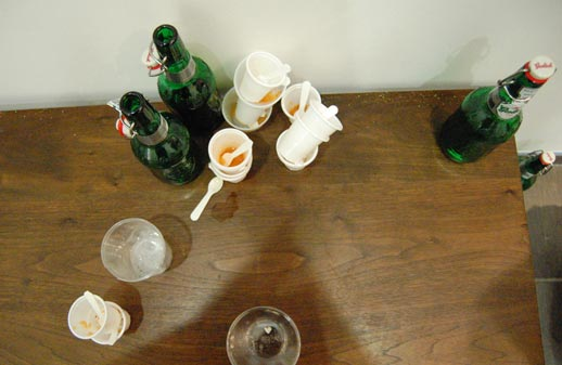 A wake of Grolsch and kimchi-flavored ice cream detritus from Miwa Koizumi's 'NY Flavors Ice Cream Stand' performance (happening next door at the George Adams Gallery). Photo © 2008 Teri Duerr.