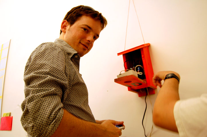 Some folks from MAKE MAGAZINE with their Bluetooth enabled chat box. When a Bluetooth device happens near, their device initiates a conversation. Photo © 2008 Teri Duerr.