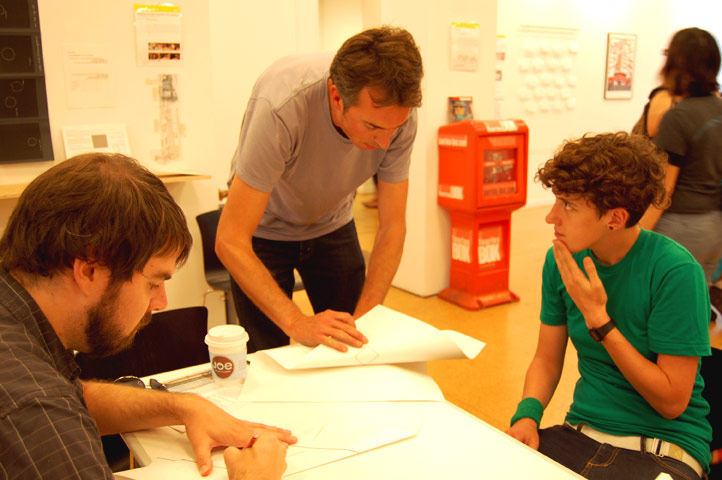 A re-mapping project with visiting UK artist Rupert Hartley (pictured center). ''It's a way to re-envision our urban environment,'' he said. Initial sketches are taken from the Conflux area maps, and participants create new geographic connections from these starting points. Photo © 2008 Teri Duerr.