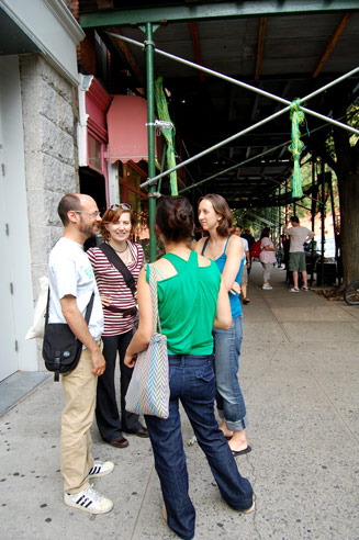 The Conflux swing, a green & yellow mass of rope installed on the outside scaffolding, was cut down by the NYPD after an angry woman complained about swinging on the sidewalk. Photo © 2008 Teri Duerr.