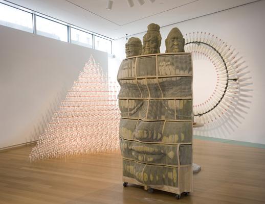 Installation view, Jill Townsley ''Spoons'' (2008); Long-Bin Chen ''Reading Chair with Buddha Heads (2007); Donald Lipski ''Spilt Milk No. 99 (2008). Photo © Richard Barnes.