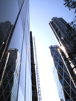 Other buildings, including the recently opened Norman Foster building reflected in the MAD facade.