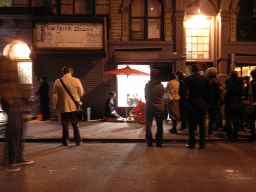 The audience spills onto Rivington Street.