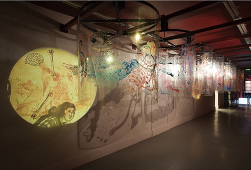 ''Remembering Mad Meg'' (installation view), 2007. Acrylic reverse painting on Lexan sheet, motors, steel amature, 2 DVDs, sound.