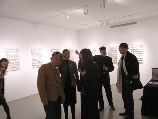 Yonehara talking with visitors, with gallerist Barry Friedman in back.