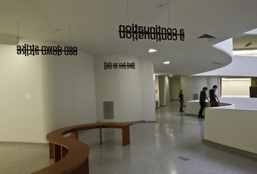 Liam Gillick, '''Theanyspacewhatever' Signage System,'' 2008 and ''Audioguide Bench, Guggenheim, NY,'' 2008 © Solomon R. Guggenheim Foundation New York. Photo by David Heald.