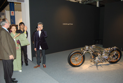 Artist Chicara Nagata with his hand-made motorcycle at Ippodo Gallery.