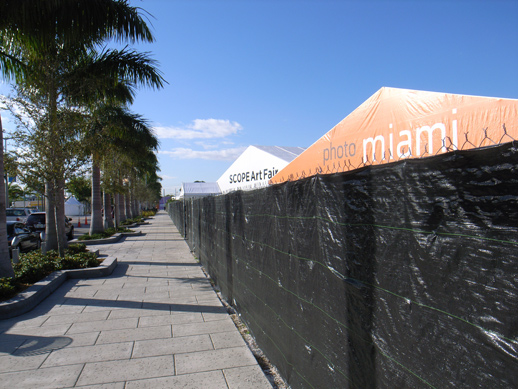 Scope Art Fair tent by Photo Miami on one side and Art Asia on the other. Nearly a dozen fairs have their tents in Midtown Miami and surrounding neighborhoods, making it easy for the Miami art shoppers to visit several events without walking. Miami Basel is about a 20 minute drive away in Miami Beach.