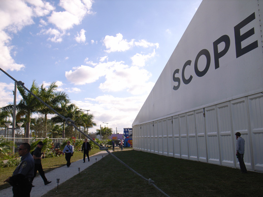 By the Scope tent.