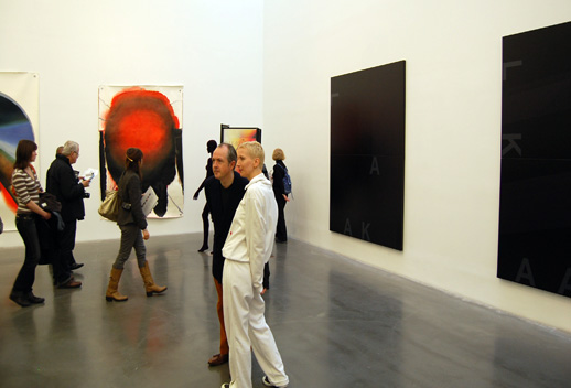 A gallery attendant wearing Ryan Gander's tracksuit, ''This Consequence,'' with embroidered stains.