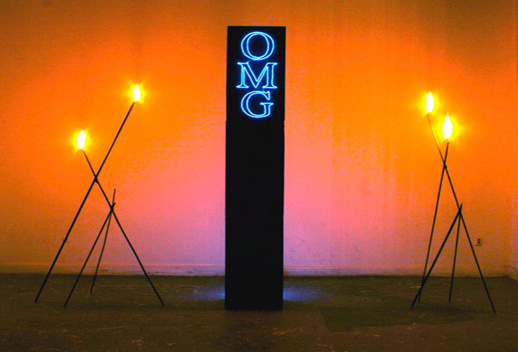 AIDS-3D, ''OMG Obelisk,'' 2007. MDF, electroluminescent wire, steel, hot glue, acrylic paint and fire. Courtesy the New Museum.