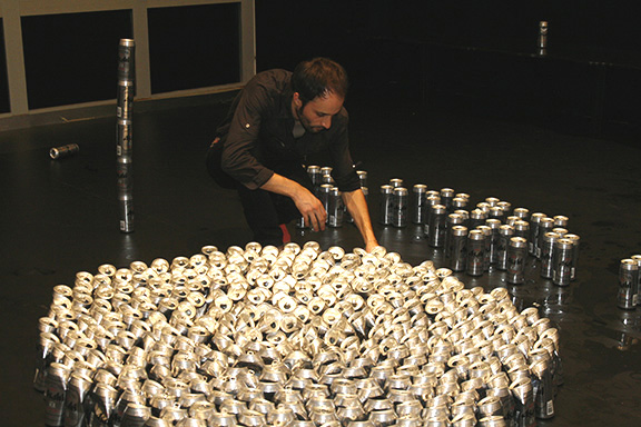 Mexico City-based artist Martin Soto Climent orchestrating his performative sculpture ''Impulsive Chorus,'' made from more than 1,000 beer cans consumed by the public on opening night. Photo: Joanne Kim, Courtesy of X Initiative.