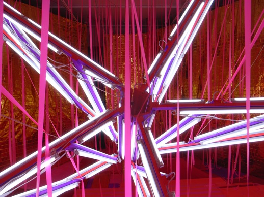Inside, neon lights and pink streamers.