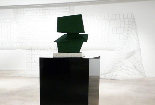 Nicolas Lobo, ''Soylent Green Bust'' 2009. Cor-ten steel, terrazzo, felt, formica pedestal, Soylent green. 24 x 12 x 12 in. Courtesy Lisa Cooley.