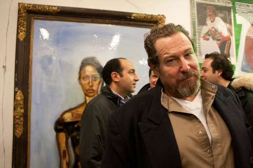 Julian Schnabel in front of his painting.