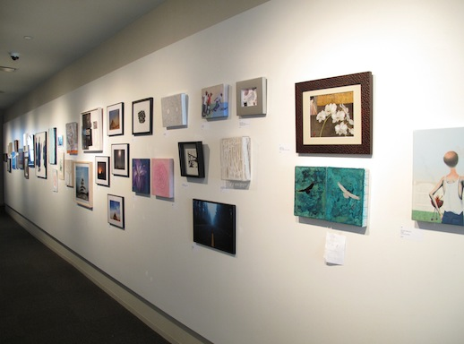 Another wall of donated art for sale.   Photo: Yu Kanbayashi