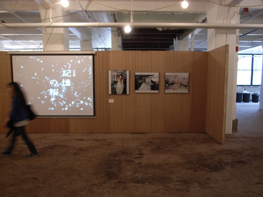 Ring Cube gallery installation with a motion activated video projection of falling cherry blossoms.