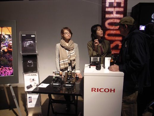 Ricoh Booth at the award party showing off the awards.