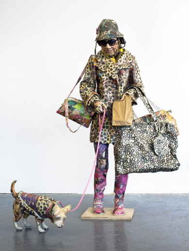 Will Kurtz 'The Bag Lady' (2011) Wood, metal wire, newspaper, glue, tape, and matte medium chain, sunglasses and dog leash 65 x 41 x 48 in.