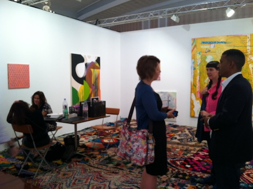 CANADA Gallery's comfortable booth at NADA. To the left and sitting down is one of CANADA's 4 founders, Suzanne Butler.  In the center is Caitlin Miller of (The Art Newspaper) speaking to kickass artist and gallery founder Sarah Braman, who is speaking to Yousef Idia, who was selling gorgeous Berber rugs off the gallery floor.