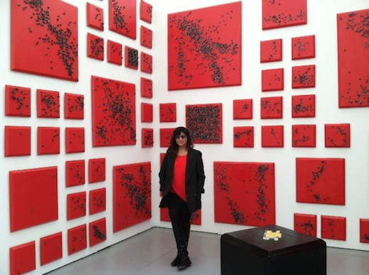 At UNTITLED, Cecilia Juardo of the LES- Y Gallery was pleased to be showing G.T. Pellizzi's red canvas with drizzled black dice pieces. She matched beautifully!