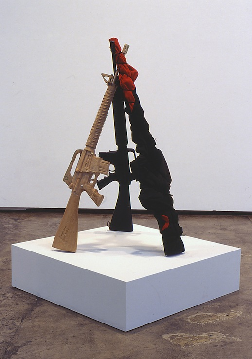 Robert Visani 'Slaves to the Rhythm' (2005) wood, fabric, metal, and rubberized M-16, 38 x 29 x 29 in.